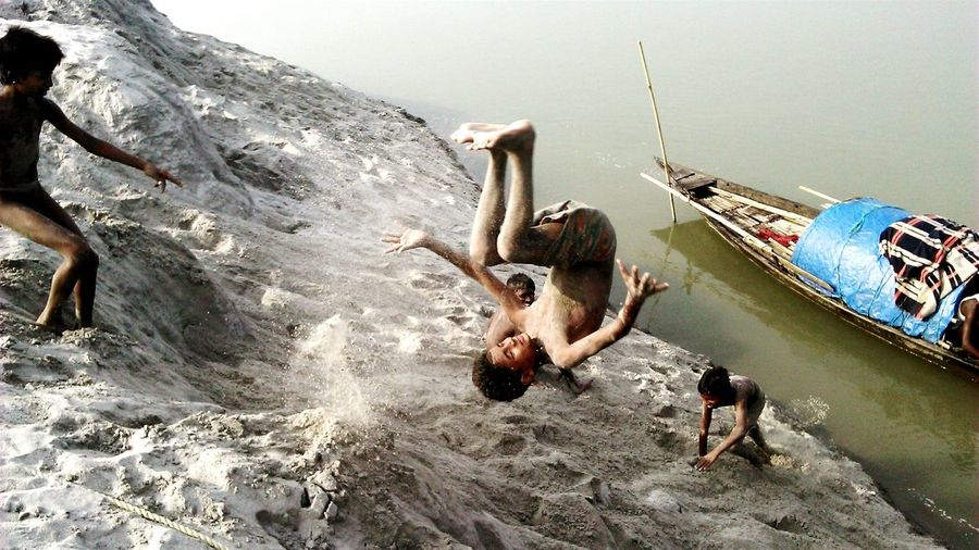 The Action Photographer - 2015 EyeEm Awards Childhood Spirits The Street Photographer - 2015 EyeEm Awards Street Photography Children Playing Somer Sault Back Flip Mobile Photography My Favorite Photo