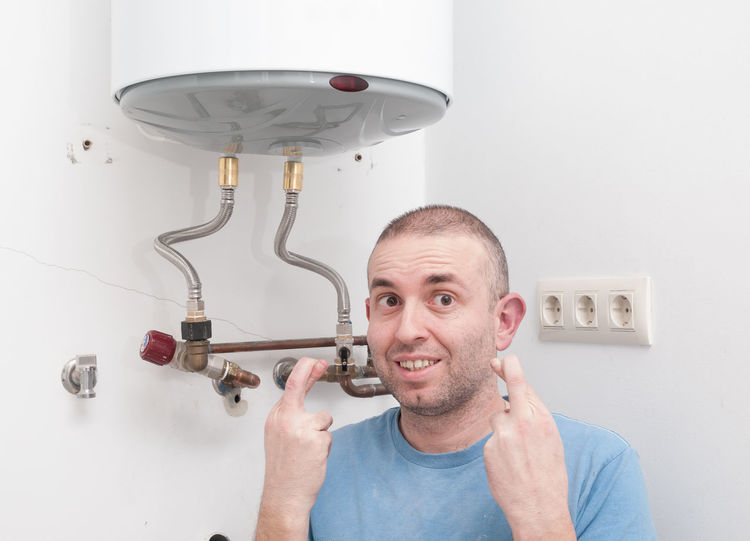 Repairing an electric boiler DIY DIY At Home Fix  Heater Home Lucky Adult Casual Clothing DIY Electric Boiler Electric Heater Front View Headshot Home Improvement Home Interior Indoors  Insecurity Maintenance Men Mid Adult One Person Portrait Real People Repair Wall - Building Feature