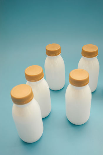 Bottle White Color Container Still Life Blue Background Close-up Group Of Objects In A Row High Angle View Side By Side Arrangement