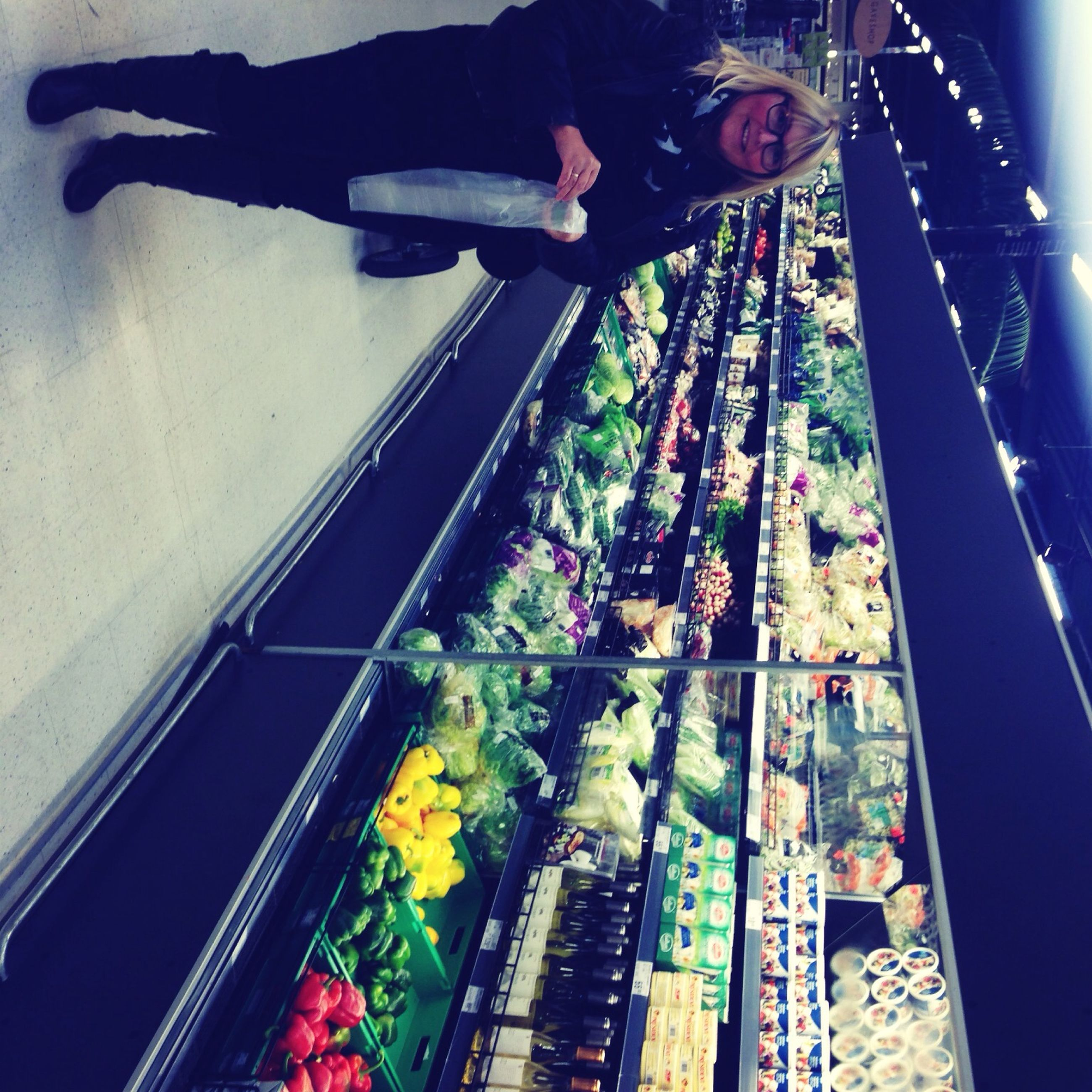 indoors, multi colored, lifestyles, standing, men, leisure activity, hanging, built structure, person, architecture, reflection, low angle view, part of, wall - building feature, low section, day, casual clothing, high angle view