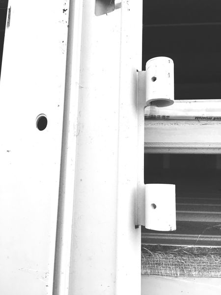 Door Accessoires EyeEm Best Shots - Black + White EyeEm Selects Blackandwhite EyeEm Selects No People Built Structure Architecture Day White Color Close-up Nature Metal Outdoors Sunlight Wall - Building Feature Low Angle View Entrance Hole Door Pattern Technology Single Object