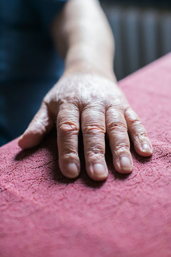 Old person's hand resting on table