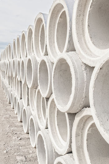 Concrete drainage pipes for industrial building construction. Large Group Of Objects No People Abundance Stack Arrangement Still Life Pipe - Tube Day Order Industry Land In A Row Nature Repetition Pattern Pipe Architecture Shape Rolled Up Outdoors Concrete Cement