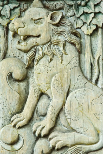 Indonesia, Bali, Ubud, Agung Rai Museum of Art - ARMA -, vertical reliefs of nature, lion Agung Rai Museum Architecture Arts And Crafts ASIA Bali, Indonesia Bas-relief Close-up Culture Day INDONESIA Lion Nature Motif No People Outdoors Ubud, Bali Vertical