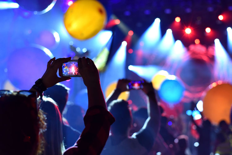 Fans Photographing Through Smart Phone While Enjoying At Music Concert
