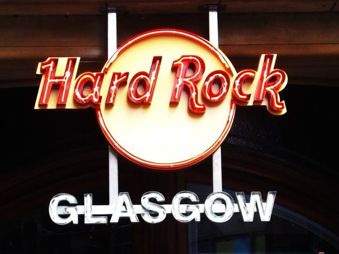 Hard Rock Cafe Rock And Roll Glasgow  Street Sign Hard Rock Cafe Sign Neon Sign Illuminated Text Nightlife Food And Drink Industry Store