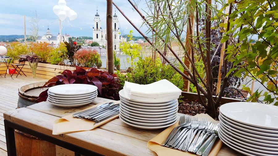 Stack of plates on table at outdoor restaurant