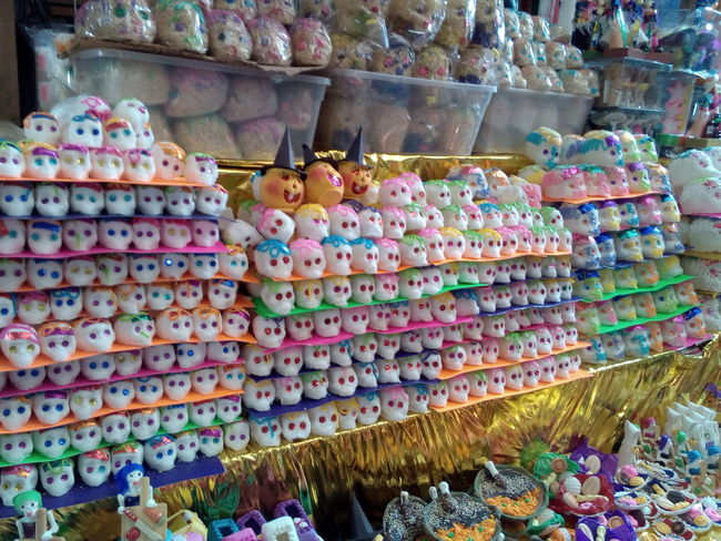 Large Group Of Objects Multi Colored Abundance For Sale Cultures Market Fiesta Guerrero Mexico No People Halloween Dıa De Muertos Skulls Candy Skull Sugar Popular Market Tradition