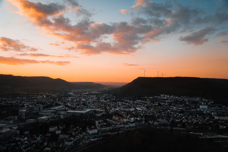 Sunset view over a german city with wind turbines, landscape format