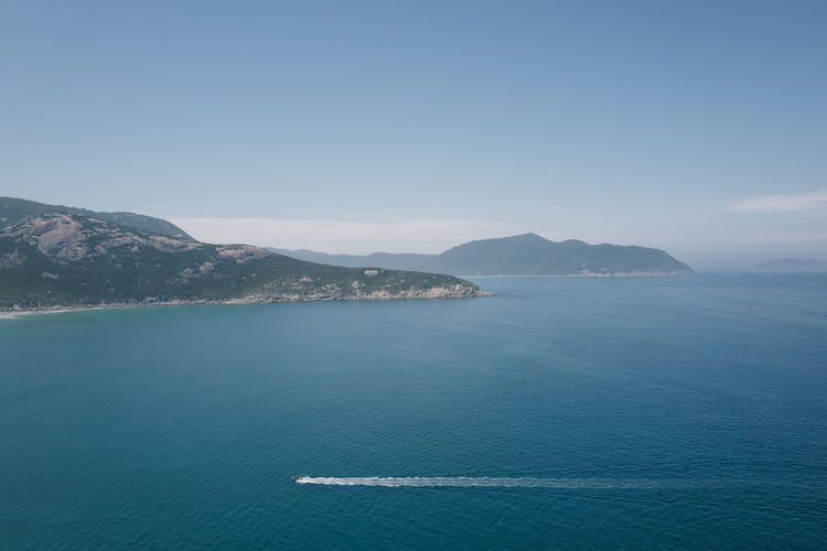 Shot at Wilsons Promontory, Gippsland. Beauty In Nature Blue Clear Sky Day Horizon Over Water Mountain Mountain Range Nature No People Outdoors Scenics Sea Sky Tranquil Scene Tranquility Transportation Wake Water Waterfront