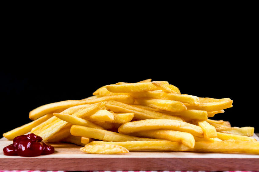 Black Background Close-up Delicious Eating Healthy Food Food And Drink French Fries Freshness Healthy Eating Indoors  No People Potato Chip Prepared Potato Raw Food Ready-to-eat Red Snack Studio Shot Yellow