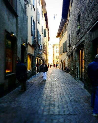 Bergamo italy Città alta City street residential building Old Town Architecture building exterior built structure pathway alley Narrow vanishing point Contrast Light And Shadow Light Effect Light At The End Of The Tunnel Bergamo Italy Città Alta City Street Residential Building Old Town Architecture Building Exterior Built Structure Pathway Alley Narrow Diminishing Perspective The Way Forward Lane Stories From The City A New Beginning A New Perspective On Life