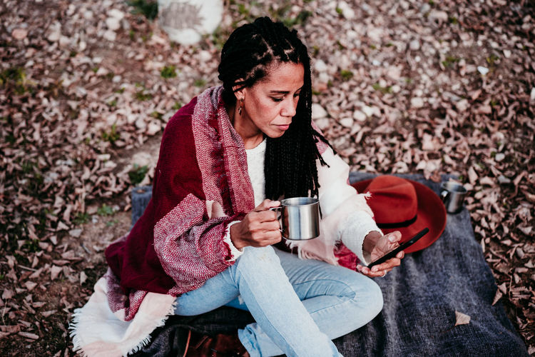 Woman drinking water from coffee