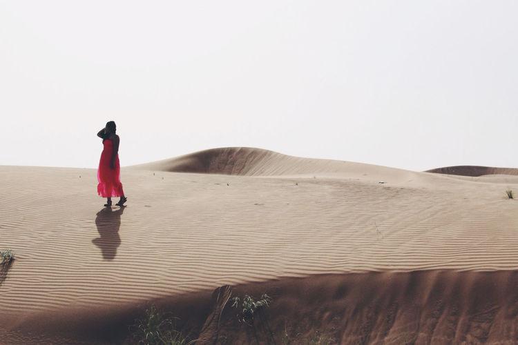 Woman walking in the desert
