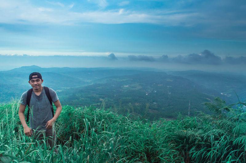 Man Standing On Mountain