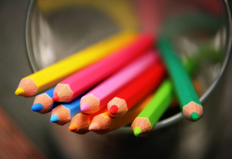 Close-up of multi colored pencils in case
