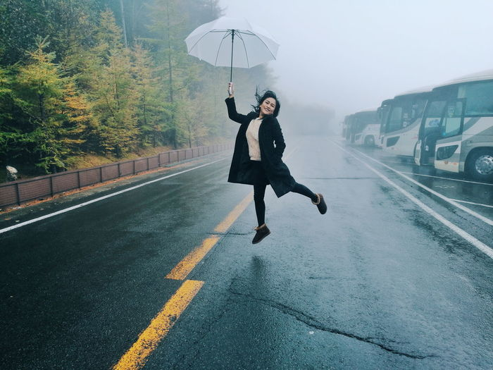 Full length of woman on road against mountain