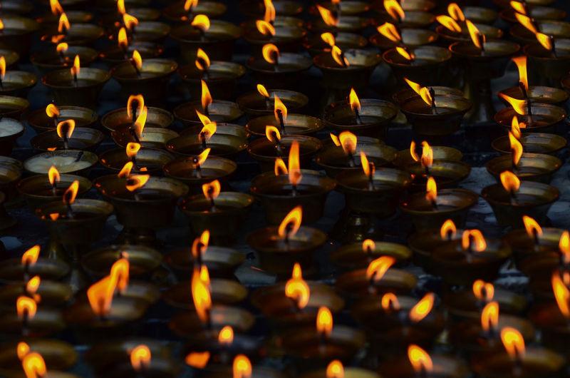 Full frame shot of illuminated diyas