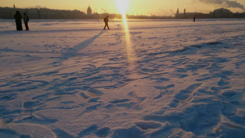People Walking over a Frozen Neva River, Saint Petersburg. It's Cold Outside Sony Xperia Zr Mobile Photography Mobilephotography Golden Hour Snow Day Ice Winterscapes Wintertime Cold Days Snow Winter Cold Freeze Freezing My Favorite Photo The City Light