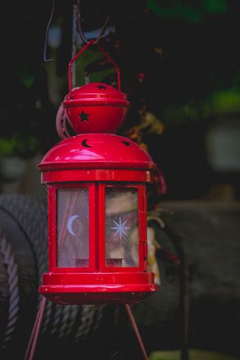 Close-up of red lantern at dusk