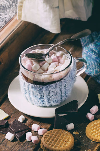 Glass cup of Hot chocolate with marshmallows in knitted cup holder with cookies, chopping chocolate and mittens over wooden window sill near frozen window in sunny day. Rustic style. Beverage Chocolate Coffee Dessert Marshmallow Pink Rustic Day Light Drink Foam Food And Drink Foodphotography Glass Hot Chocolate Hot Drink Indoors  Mug Ready-to-eat Sweet Sweet Food Table Unhealthy Eating Window Window Sill