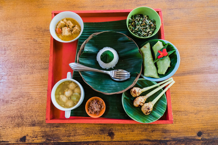 High angle view of different indonesian dishes.
