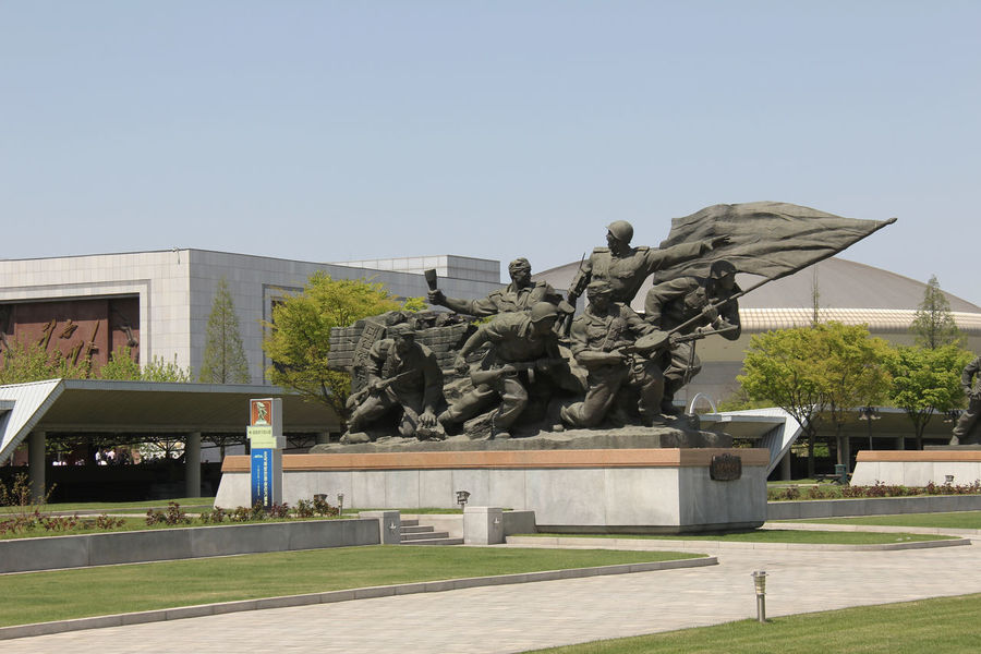 Statue Socialism North Korea Photos North Korea Outdoors Poor  Kim Jong Un Kim Il Sung Kim Jong Il Communism Pyongyang Streets Pyongyang Government Propaganda Pyongyang Architecture People Korea Dictator ASIA Politics And Government Politics Built Structure Building Exterior Architecture Red