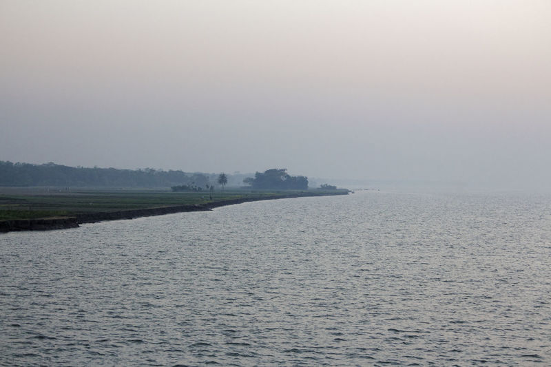 The usual view of rural Bangladesh Bangladesh Beauty In Nature Nature Outdoors River Riverbank Rural Landscape Rural Scene Scenics Sky Sunset Tranquil Scene Tranquility Vacations Water