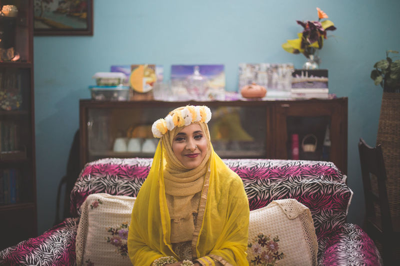 Portrait Of Bride Wearing Traditional Clothing Sitting At Home