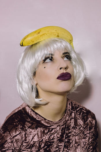 Portrait of woman with banana on head
