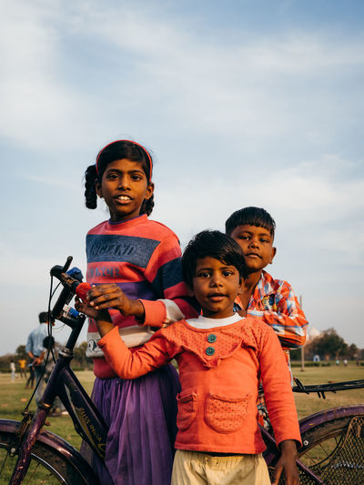 Three young children pose for a photo near the Taj Mahal. Child Sky Childhood Togetherness Looking At Camera Family Portrait Males  Lifestyles Men Real People Leisure Activity Boys Bonding People Females Two People Three Quarter Length Front View Innocence Sister Outdoors Son Positive Emotion Week On Eyeem Agra Children Indoors  India Tranquility