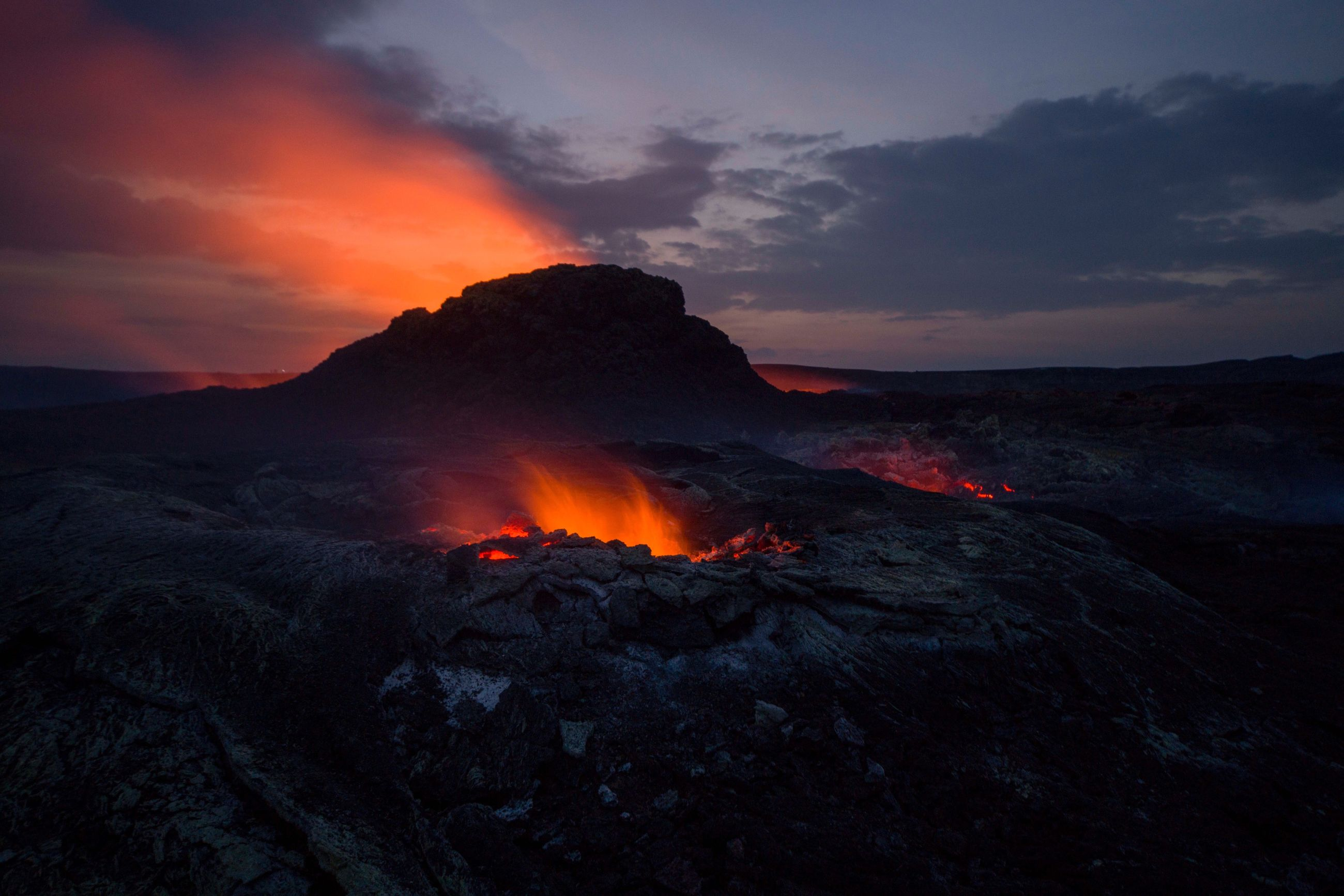 sky, cloud - sky, lava, volcano, heat - temperature, mountain, beauty in nature, geology, orange color, nature, erupting, power in nature, environment, no people, power, scenics - nature, non-urban scene, land, physical geography, smoke - physical structure, outdoors, volcanic crater, flowing