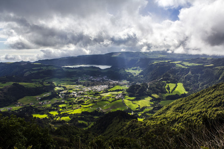 Scenic Azores landscape Azores Field Green Color Scenic Travel Aerial View Azores, S. Miguel Beauty In Nature Cloud - Sky Coutryside Environment Green Color Greenery Hill Lake Landscape Mountain Nature No People Non-urban Scene Scenics - Nature Tranquil Scene Valley