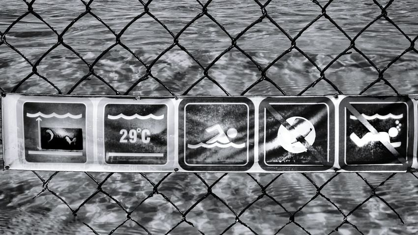 EyeEm Man Black And White Blackandwhite Photography Water Protection Safety Metal Chainlink Fence Close-up Sky Warning Fence Signboard Board Forbidden Warning Sign Information My Best Travel Photo