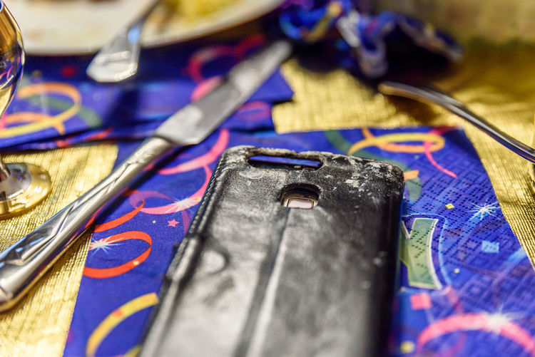 Closeup smartphone with paint drops on it colorful party table Celebration Art And Craft Art And Craft Equipment Blue Brush Close-up Craft Creativity Equipment High Angle View Indoors  Metal Multi Colored No People Party Scissors Selective Focus Smartphone Still Life Table Textile Tool Work Tool