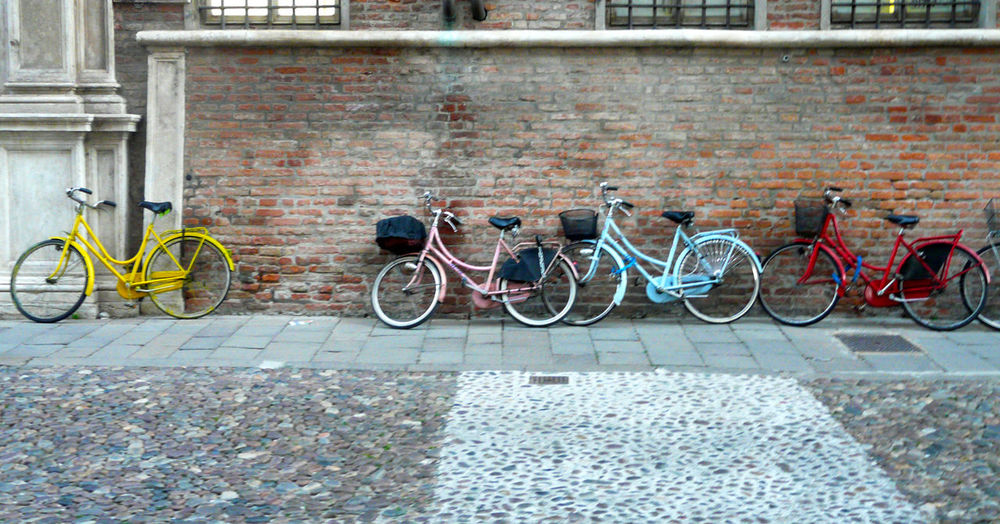 Bicycles parked on wall