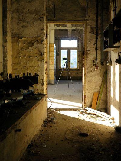 Tripod in damaged house