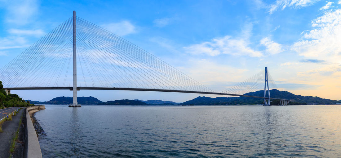 Bridge Bridge - Man Made Structure Sky Connection Water Transportation Built Structure Cloud - Sky Suspension Bridge Engineering Architecture Nature River Cable-stayed Bridge Travel Destinations Day Outdoors Bay Long Sunset Onomichi Islands Island Road Cycling Seascape Sea Panoramic Wide Angle