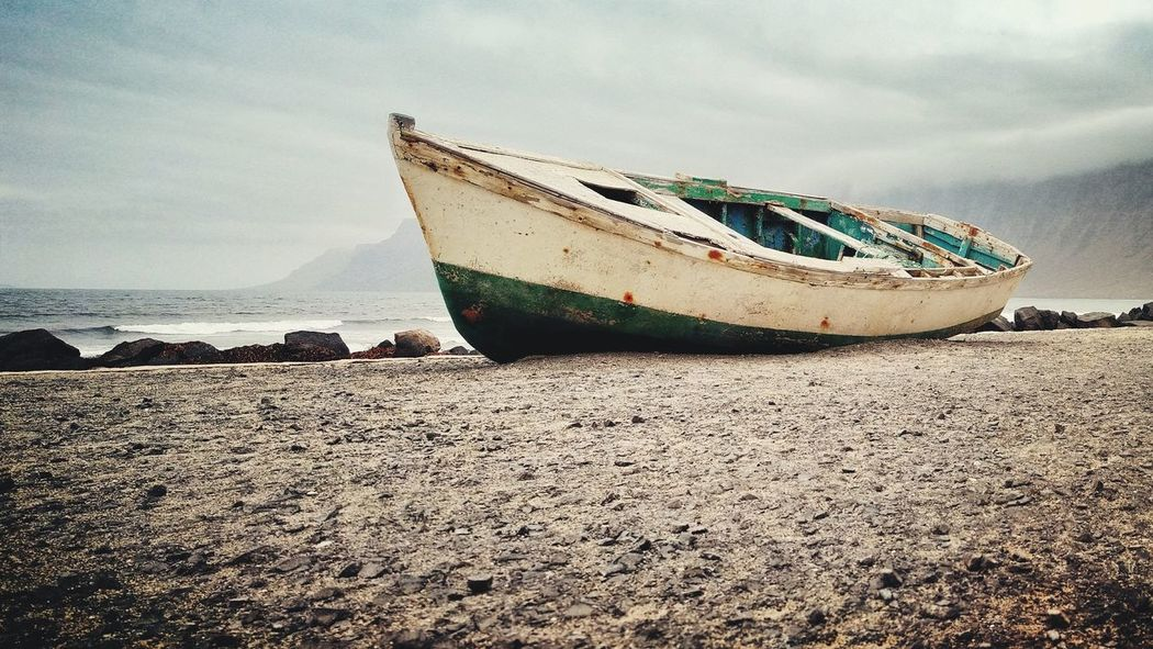 EyeEm Selects Beach Sea Nautical Vessel Sand Transportation Water Mode Of Transport No People Day Nature Outdoors Horizon Over Water Sunken Sky UnderSea
