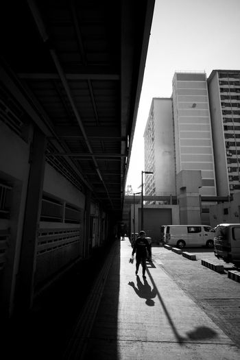 The Street Photographer - 2018 EyeEm Awards Architecture Building Building Exterior Built Structure City City Life Day Full Length Land Vehicle Mode Of Transportation Nature Office Building Exterior One Person Outdoors Real People Shadow Skyscraper Street Sunlight Transportation Travel Walking