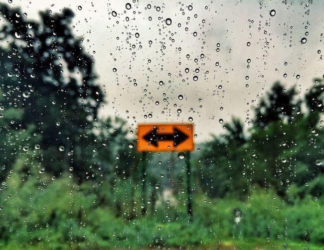 Raindrops on glass window in rainy season