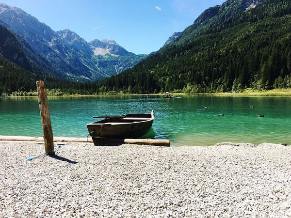 Mountain Nature Water Scenics Beauty In Nature Lake Mountain Range Nautical Vessel Tranquil Scene Tranquility Lakeshore Sky Tree Day Outdoors No People Austria Lake View Mountains Österreich Summer Sun Boat EyeEm Best Shots Nature