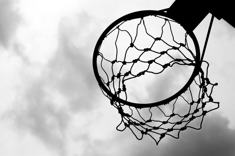 Black and white of Old basketball hoop on sky background and clouds Backboard Background Ball Basket Basketball Black And White Blue Board Circle Cloud Competition Copy Space Court Equipment Exercise Fun Game Goal Health Hoop Metal Net Old Outdoor Play Playground Recreation  Ring Round School Score Shot Sky Space Sport STAND Success Team White