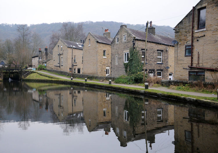 canalised houses in hebden bridge west yorkshire Hebden Bridge Houses Architecture Building Exterior Built Structure Canal Day Nature No People Outdoors Reflection Sky Water