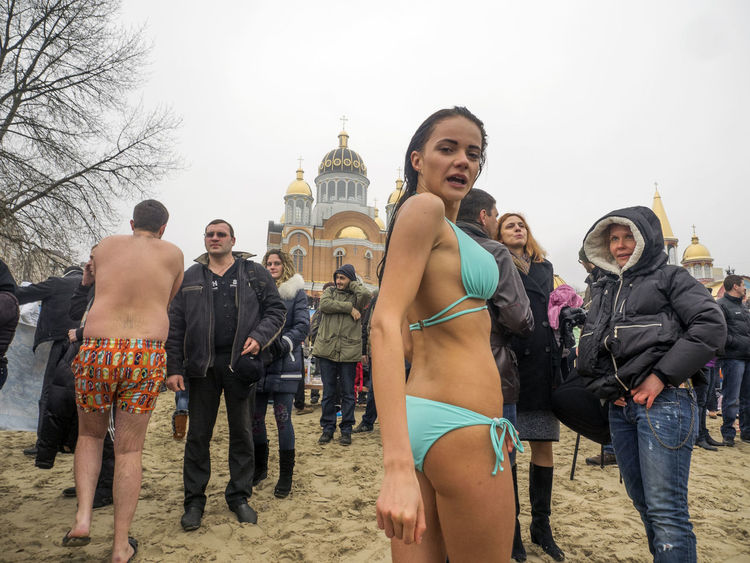 Great Christian holiday Epiphany on the banks of the Dnieper Banks Casual Clothing Christian Clear Sky Cold Day Dnieper Epiphany Footpath Friendship Great Holiday Leisure Activity Lifestyles Mask - Disguise Outdoors People And Places Person Religion River Sky Standing Togetherness Vacations Winter