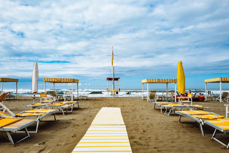Camaiore Tuscany Absence Beach Beauty In Nature Chair Cloud - Sky Day Empty Horizon Over Water In A Row Italy Nature No People Outdoors Relaxation Sand Scenics Sea Sky Sun Lounger Table Tranquil Scene Tranquility Vacations Water
