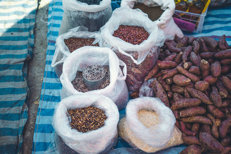 High angle view of food grains for sale at market stall