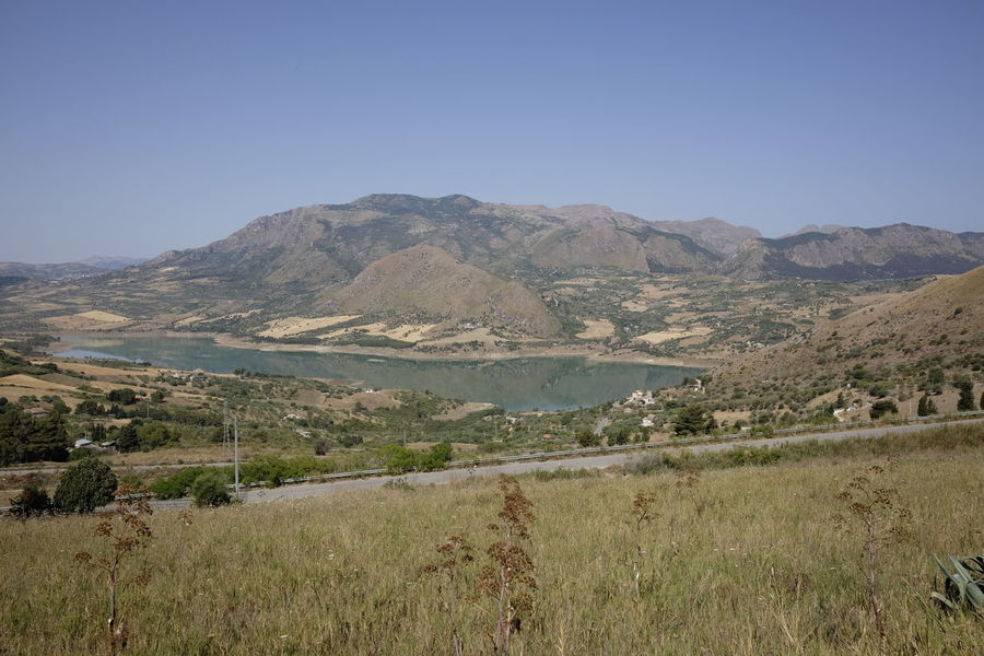lake rosamarina Arid Climate Beauty In Nature Clear Sky Day Field Grass Lake Landscape Mountain Mountain Range Nature No People Outdoors Scenics Sky Tranquil Scene Tranquility