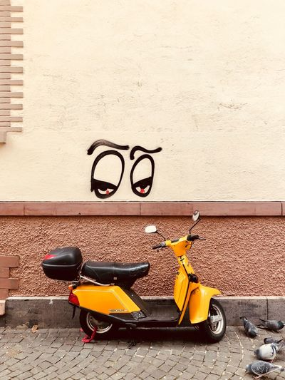 Motor scooter on wall
