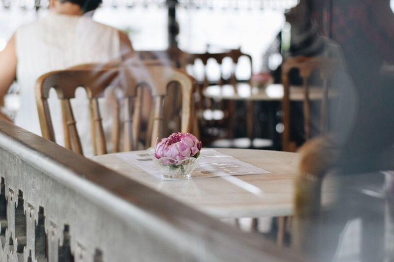 View of purple flower on table at restaurant
